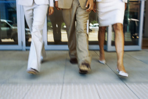 low section view of three people walking --- Image by © Royalty-Free/Corbis